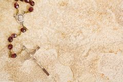 Rosary on stone stock photography