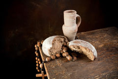 Rosary and wine jug Royalty Free Stock Images