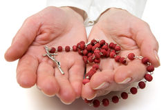 Rosary in the woman hands. Stock Photography