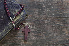 Rosary on wooden board Royalty Free Stock Image