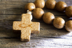 Rosary on wooden board with sign of fish Royalty Free Stock Photography