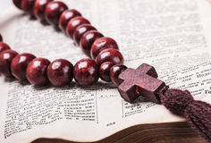 Rosary with a wooden cross Royalty Free Stock Photo