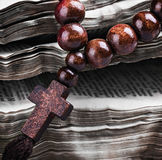 Rosary with a wooden cross Stock Image