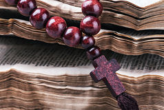 Rosary with a wooden cross Royalty Free Stock Photography