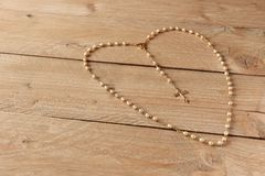 Rosary on wooden floor Royalty Free Stock Image