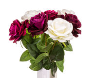 Rosas artificiais no vaso isolado Imagem de Stock