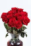 Rosas dúzia vermelhas fotografia de stock