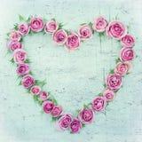 Rosas en una forma del hogar Imágenes de archivo libres de regalías