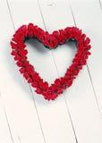 Rosas que forman el corazón del amor Fotos de archivo