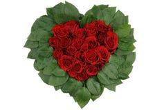 Rosas rojas, corazón de las hojas Imagenes de archivo