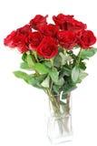 Rosas rojas en un florero Foto de archivo