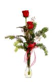 Rosas rojas en un florero cristalino Fotografía de archivo libre de regalías