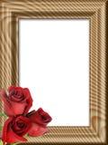 Rosas rojas en un marco de madera Fotos de archivo libres de regalías