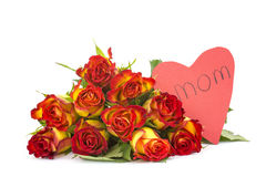 Rosas rojas y amarillas y corazón Foto de archivo