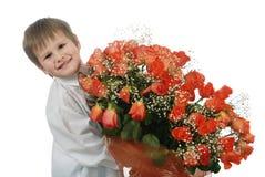 Rosas y muchacho Imagen de archivo libre de regalías