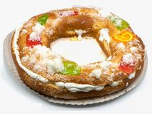 Roscon de reyes, typical Spanish dessert of Epiphany, isolated on white background royalty free stock photography