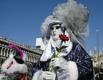 The Rose. A woman with a rose is dressed for Carnivale in Venice,Italy Royalty Free Stock Photo