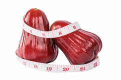 Rose apple and  white tape Stock Images