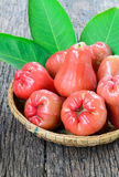 Rose apple on wood basket Stock Images