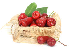 Rose apples on wooden crate Stock Images