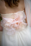 Rose applique on a bride's wedding gown Royalty Free Stock Photography