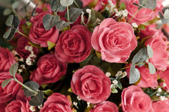 Rose artificial flowers background. Stock Photos