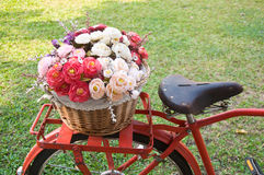 Rose artificial flowers in vintage bicycle Stock Photography