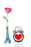Rose au coeur de pot et d'horloge Photo libre de droits