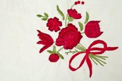 Rose auf Baumwollhintergrund stockfotografie
