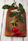 Rose auf den Brettern Stockfotos