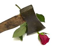 Rose and axe Royalty Free Stock Photography