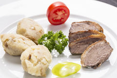 Rose baked duck breast, with pepper cream, and roasted potatoes Royalty Free Stock Images