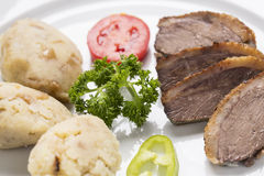 Rose baked duck breast, with pepper cream, and roasted potatoes Stock Image
