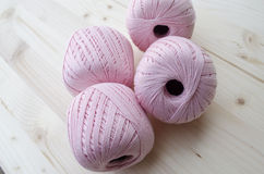 Rose ball  thread yarn on white wood Stock Image