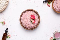 Rose bath salt with flowers and natural oil bottles on white background royalty free stock images