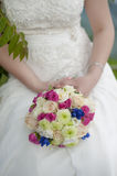 Rose, blue and white wedding bouquet. In the hands of the bride and groom Royalty Free Stock Photography
