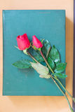 Rose and book Stock Photography