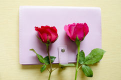 Rose on book and wood background Stock Images