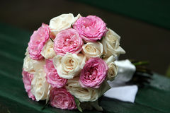Rose Bouquet. Wedding Bouquet laying on a park bench Royalty Free Stock Photos