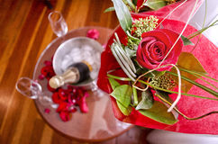 Rose bouquet and Champagne. A bird's eye view shot of a bouquet of red roses and champagne on ice Royalty Free Stock Image
