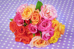 Rose bouquet of different colors on the table Stock Photos