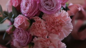 Rose bouquet rotating, multi colored, zoom in stock video footage