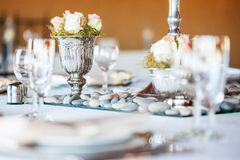 Rose bouquet in silver vase at wedding reception Royalty Free Stock Photo