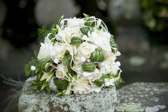 Rose bouquet on wedding. Rose bouquet on rock at wedding Royalty Free Stock Images