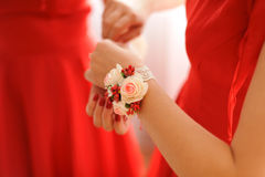 Rose Boutonniere. With lace ribbon on bridesmaid's hand stock photos
