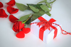 A rose and a box background Stock Photography