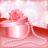 Rose and box with pearl necklace Stock Photography
