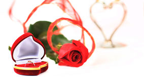 Rose and a box with rings Stock Photo