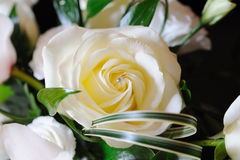 Rose in brides bouquet. Closeup of rose in brides bouquet on wedding day Stock Images