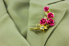 Rose brooch. On a business female suit of Royalty Free Stock Images